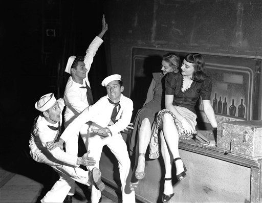 "A scene from the ballet ""Fancy Free,"" which tells of the trials of three American soldiers on shore leave, during a rehearsal November 17, 1950 in the Theatre du Palais de Chaillot in Paris, France prior to its performance there by the American Ballet Theatre troupe, on tour of Europe. The choreography of this American ballet is by Jerome Robbins and the music by Leonard Bernstein. Dancers are from left: Eric Braun, John Kriza, Paul Godkin, Paula Lloyd and Allyn McLerie. (AP Photo)"