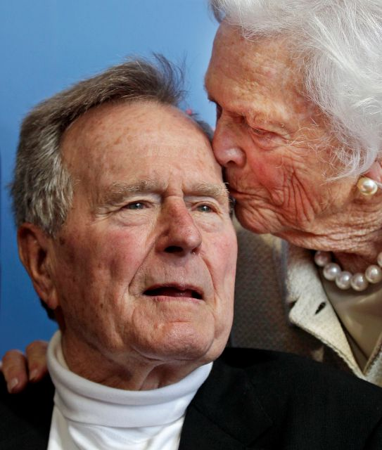 FILE - In this June 12, 2012 file photo, former President George H.W. Bush, and his wife, former first lady Barbara Bush, arrive for the premiere of HBO