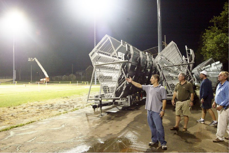 Mayor Mark Benigni, left, with City Council majority leader Steve Zerio, 2nd from left, Parks and Rec. foreman Pete Daniels, 2nd from right, and Parks and Rec. director Mark Zebora, right, inspect the newly installed lights at Ceppa Field Thurs. night, Sept. 4, 2003.