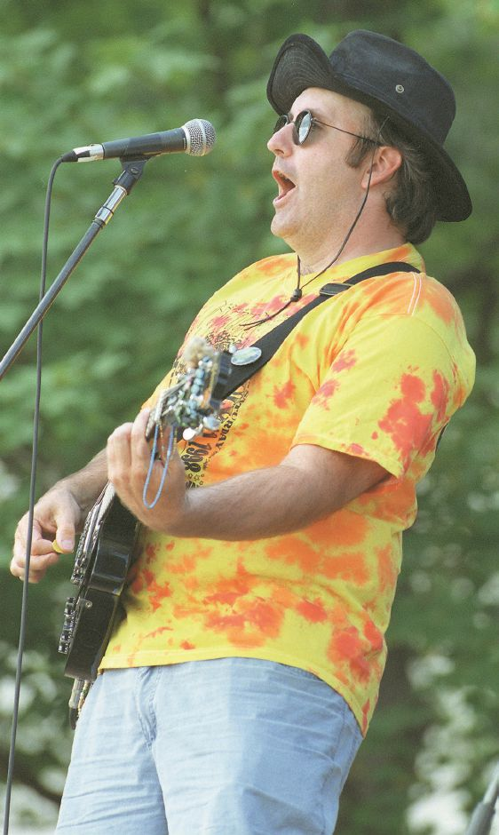 RJ file photo - Paul Heriot, lead for the band Presidential Targets, belts out a tune on the stage during the Wallystock concert in Wallingford, Aug. 1998.