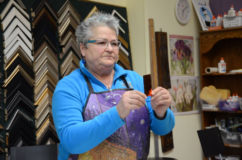 Instructor Christine Webster shows her students an example of cut glass.