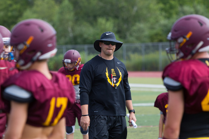 Above: Steve Zenisky, left, lines up against William Seay in a recent Sheehan practice. The two will play side by side this fall on the left side of the offensive line, Zenisky at tackle and Seay at guard.Below: Heading into his 13th season, Sheehan head coach John Ferrazzi is the second-longest tenured coach in the SCC behind only Shelton's Jeff Roy (14 seasons). | Justin Weekes, Special to the Record-Journal
