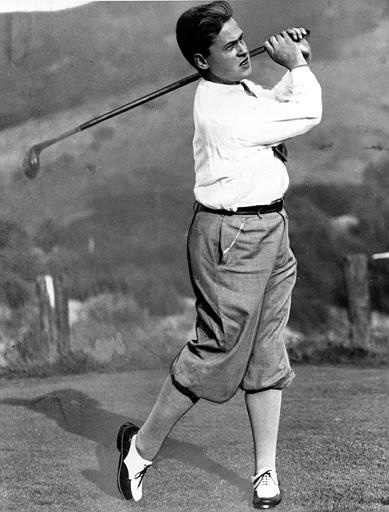 Amateur golfer Bobby Jones of Atlanta, Ga., follows through on his swing at the start of a nine-hole practice round, and his first ever shot in the Pacific coast, at Lakeside Country Club in Los Angeles, Ca., Aug. 22, 1929.  (AP Photo)
