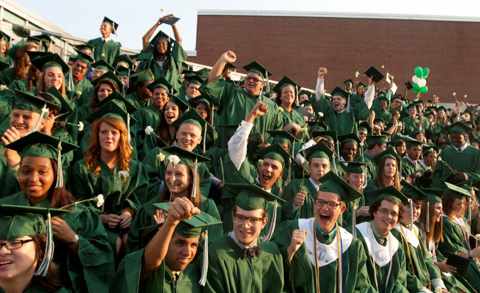 Graduates cheer as the last member of the Maloney Class of 2012 is called to the stage to receive his diploma during the graduation ceremony at Maloney High School Wednesday evening, June 20, 2012. (Christopher Zajac / Record-Journal)