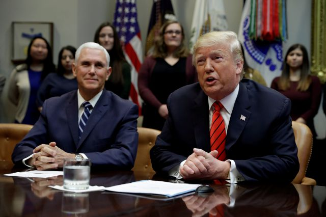 President Donald Trump arrives to speak to NASA astronauts carrying out the first ever all-female spacewalk, during a call from the Roosevelt Room of the White House, Friday, Oct. 18, 2019, in Washington, as Vice President Mike Pence looks on. (AP Photo/Evan Vucci)
