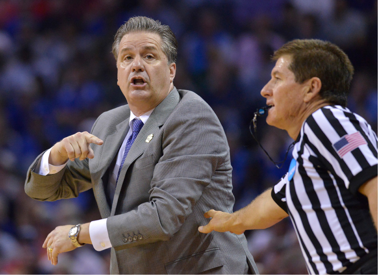 Kentucky head coach John Calipari speaks to players the second half of an NCAA college basketball tournament South Regional semifinal game against UCLA, Friday, March 24, 2017, in Memphis, Tenn. (AP Photo/Brandon Dill)