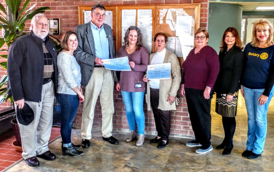 Checks were presented to Kristen Schechter of Cheshire Human Services;