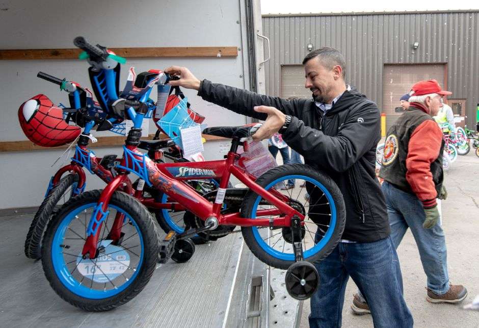 Bikes are loaded into trucks after Manafort Brothers Inc, of Plainville, donated 100 bikes to the Marine Reserves Toys for Tots program on Dec. 12, 2018. | Devin Leith-Yessian/Plainville Citizen