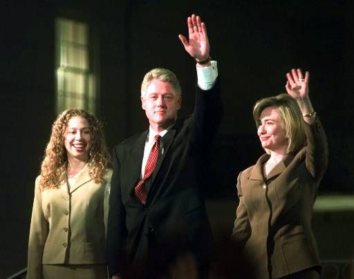 President Clinton, wife Hillary and daughter Chelsea wave to supporters in front of the Old State House during an election night celebration in Little Rock, Ark., Tuesday, Nov. 5, 1996. (AP Photo/David Longstreath)