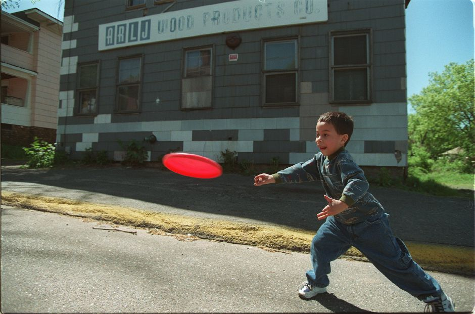 RJ file photo - Frankie Burgos, 5, lets a Frisbee fly to a friend, Sulim Villanueva on Morgan Street in Meriden May 12, 1999.