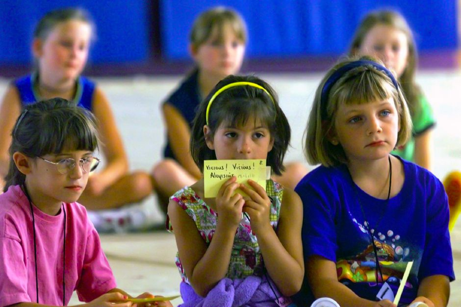 Holding a flash card that has her line , Michelle Gansley, 7, waits with Brittany Wieloch , 7, and other children to recite their lines during a religious musical rehearsal at St. Stanislaus Vacation Bible School Tuesday July 13, 1999. The summer program runs this week at the church.