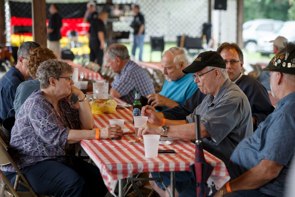 Visitors enjoy food and music Saturday during Bierfest at the Meriden Turner Society in Meriden. The 152 year old Society celebrates German cultural, food, music and dancing.  August 11, 2018 | Justin Weekes / Special to the Record-Journal