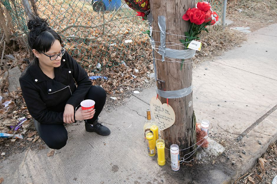 Yaricely Zenquis, of Meriden, reflects at a memorial for friend Aaron Joseph Ormsby, 21, near a residence at 130 Foster St. in Meriden, Fri., Jan. 18, 2019. Ormsby was shot and killed in back of the residence Thursday night. Dave Zajac, Record-Journal