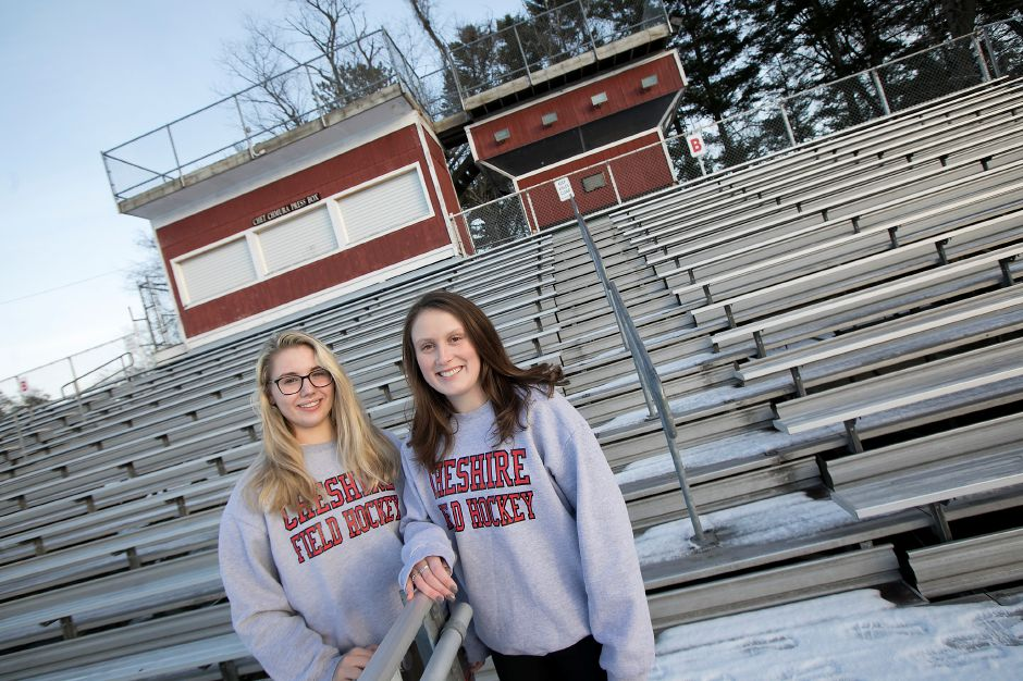 Seniors Mia Pulisciano, left, and Julia Schaff, both 17, pose in the stands at Cheshire High School Friday. The two field hockey teammates encourage sportsmanship in the student seating section during athletic events. Dave Zajac, Record-Journal
