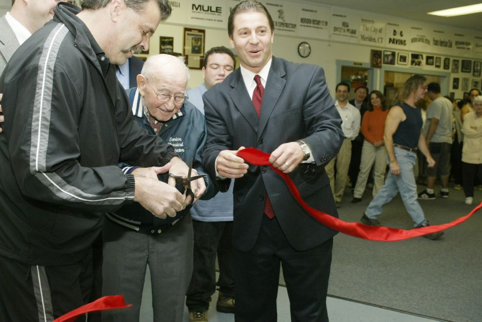 From left, Larry Pelletier, director of Beat the Street Community Center, Max Muravnick, oldest member of the center, and Mayor Mark Benigni cut the ribbon to open the new center above Belval Company on South Colony Street on Nov. 1, 2005. Beat the Street moved from their old location on Railroad Ave. after the lease expired.