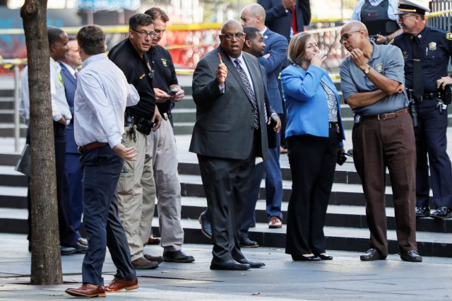 Cincinnati Police Chief Eliot Isaac, center, works the scene as emergency personnel and police respond to reports of a shooting near Fountain Square, Thursday, Sept. 6, 2018, in downtown Cincinnati. (AP Photo/John Minchillo)