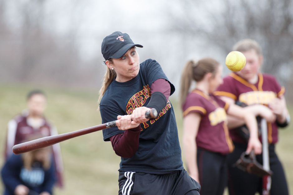 Sheehan softball coach Sarah Wyant and her team are going head to head and joining forces with rival Lyman Hall in Wednesday night's game at Pragemann Park. The teams are raising funds to defray medical expenses for the families of Sheehan students Jordan Davis and Tre Childers, who were injured in a car accident last month.  | Justin Weekes / Special to the Record-Journal
