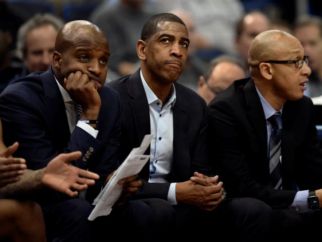 Connecticut head coach Kevin Ollie, center, watches play with assistant coach Dwayne Killings, left, and associate head coach Raphael Chillious during the first half an NCAA college basketball game against Tulsa, Thursday, Feb. 15, 2018, in Hartford, Conn. (AP Photo/Jessica Hill)