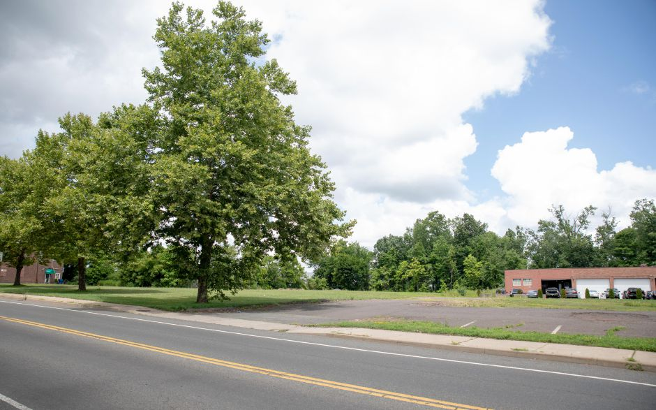 The former site of Pioneer Precision Products at 889 Farmington Avenue in Berlin, photographed in July 2019, is planned to become the site of a new five building development connected to the adjacent train station. | Devin Leith-Yessian/Berlin Citizen