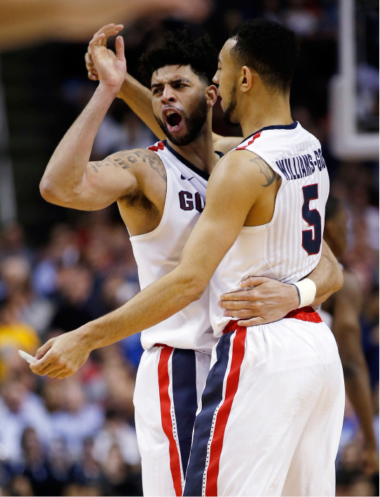 Gonzaga guard Josh Perkins, left, celebrates with teammate Nigel Williams-Goss, right, after a win over West Virginia during the second half of an NCAA Tournament college basketball regional semifinal game Thursday, March 23, 2017, in San Jose, Calif. (AP Photo/Tony Avelar)