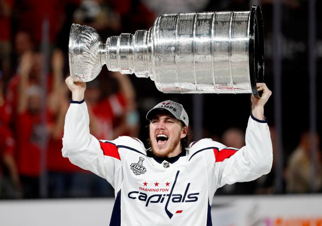 Washington Capitals right wing T.J. Oshie hoists the Stanley Cup after the Capitals defeated the Golden Knights 4-3 in Game 5 of the NHL hockey Stanley Cup Finals Thursday, June 7, 2018, in Las Vegas. (AP Photo/John Locher)