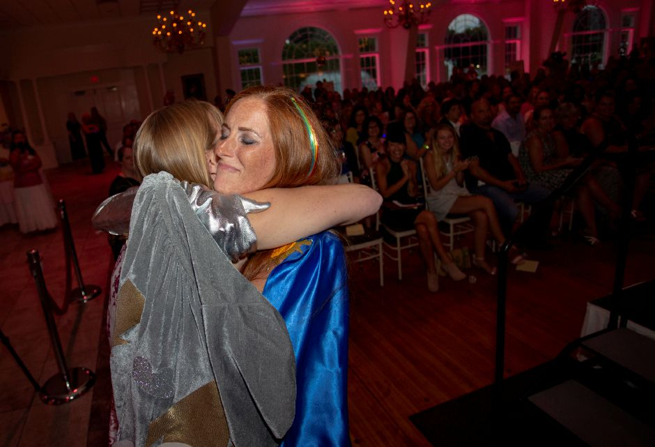 Kristen Tyrseck, right, gives a hug to Christine Willett, After the Storm founder and president, at the Art Bra 2018 fundraiser Aug. 9. Richie Rathsack, Record-Journal