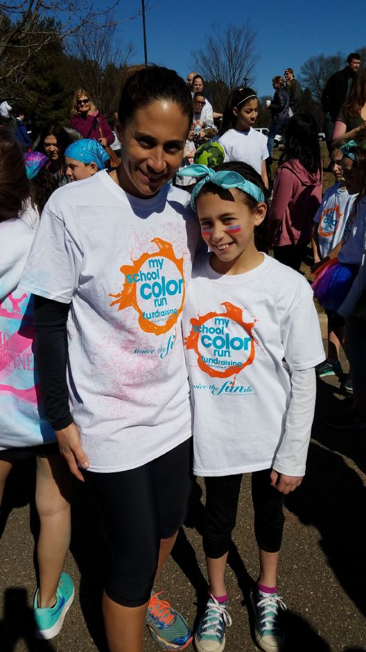 Stacey O'Connor, fourth grade teacher at Ridge Road Elementary School, and her daughter participated in the My School Color Run at North Haven High School on April 2, 2017. O'Connor is organizing the community-wide again this year. | Contributed by Stacey O'Connor