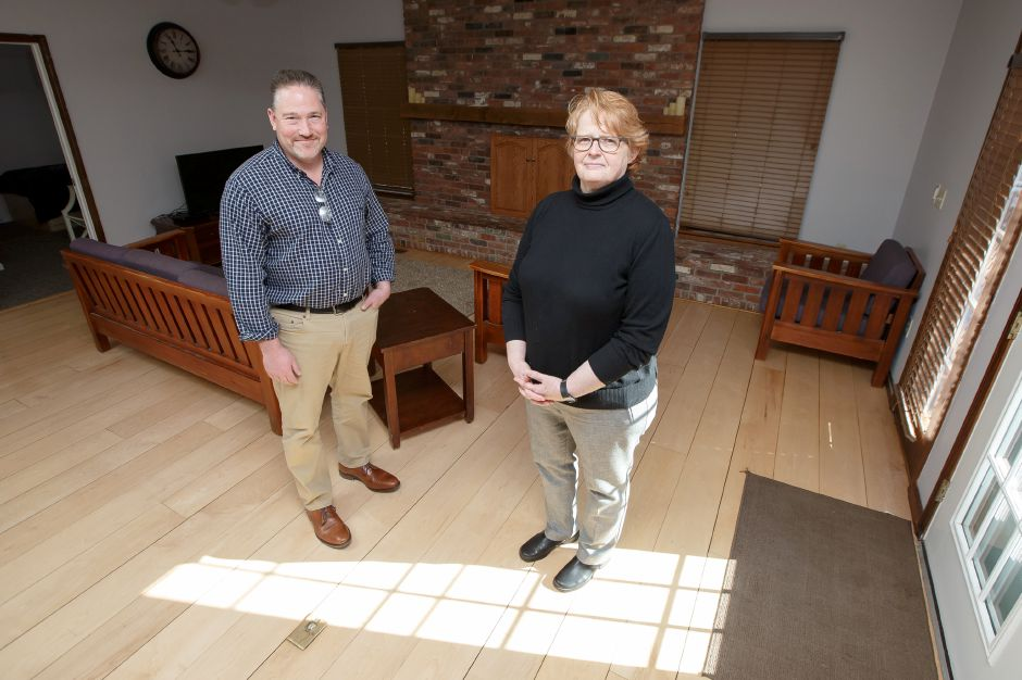 Executive Director Margaret Hann and Director of Resident Services Mike Rulnick stand for a portrait in the living room of the Bridge Family Center Winifred House in Southington. The home ranked third on a list of top police call locations with 43 calls in the previous fiscal year. File photo | Justin Weekes/Special to the Record-Journal