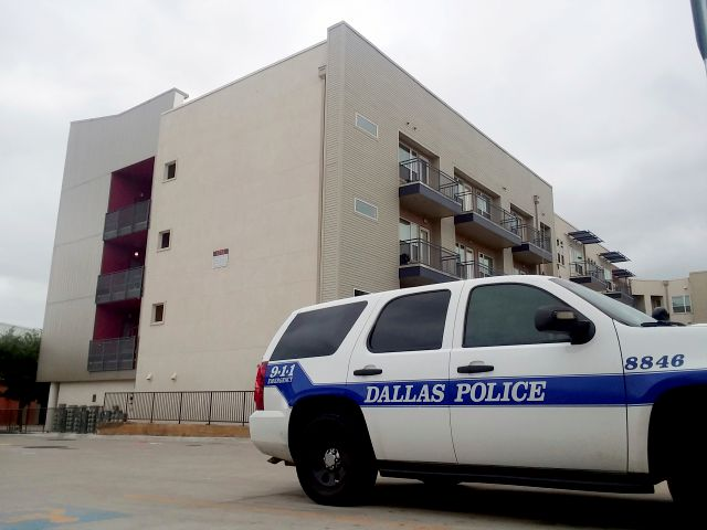 FILE - In this Sept. 10, 2018, file photo, a Dallas Police vehicle is parked near the South Side Flats apartments in Dallas. Former Dallas Police Officer Amber Guyger fatally shot an unarmed black neighbor whose apartment she said she entered by mistake, believing it to be her own. It's unclear when Guyger first talked to investigators about the September 2018 shooting, but she was eventually charged and is serving 10 years in prison after being convicted of murder this month. (AP...