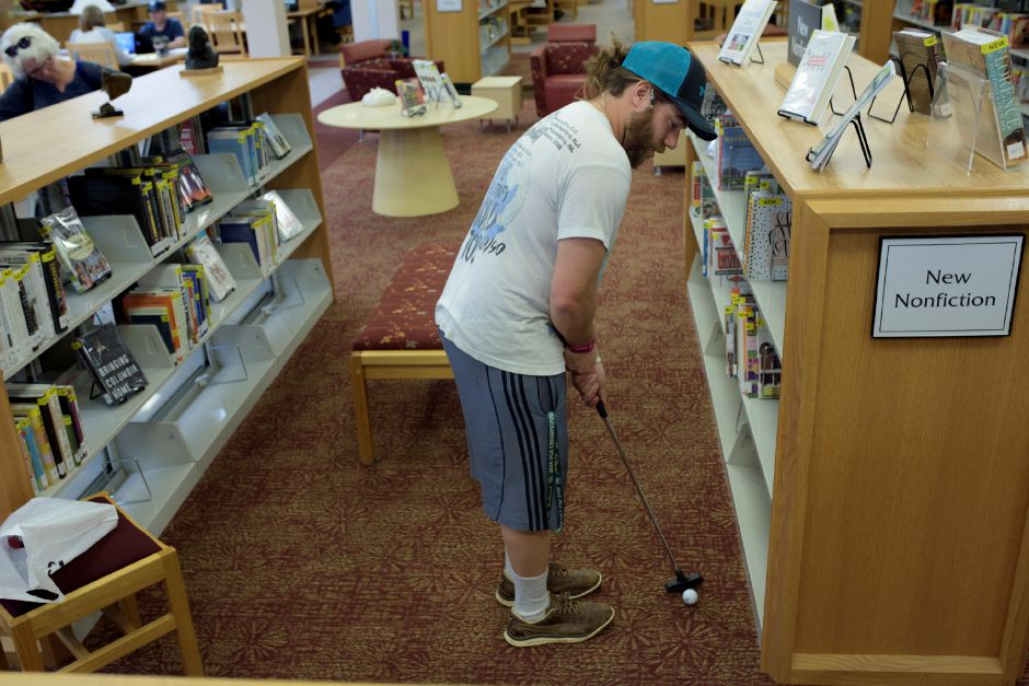 Wallingford resident Ryan Boroski runs the course on the upper floor of the library. The Wallingford Public Library set up a mini-golf course on Saturday for ages 5+. Proceeds would benefit the library. Monica Jorge/Special to the Record-Journal