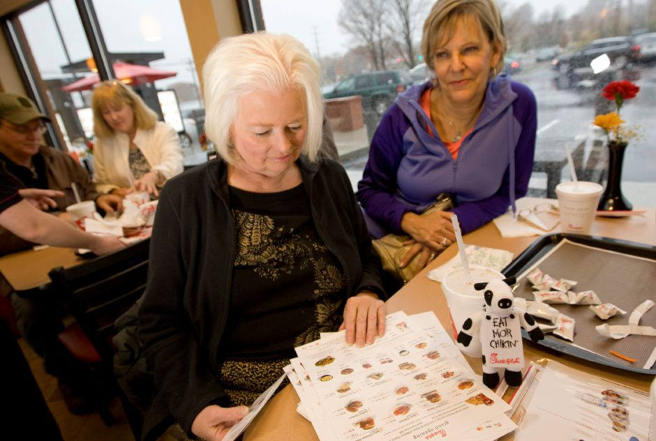 Linda Johnson, of Burlington, left, looks over a menu next to Sandy Martin, of Farmington during the grand opening of Chick-fil-A in Wallingford, Thursday, November 6, 2014. | Dave Zajac / Record-Journal