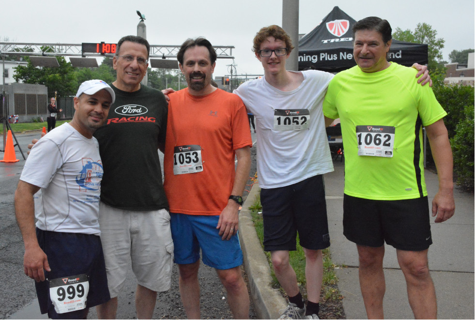 Councilman Miguel Castro, Fred Bucchieri, David Radcliffe, Ben Radcliffe, and Rob Vivari at the finish line of the one mile race. | Ariana D