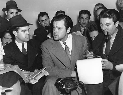 Orson Welles, center, explains to reporters on Oct. 31, 1938 his radio dramatization of H.G. Wells