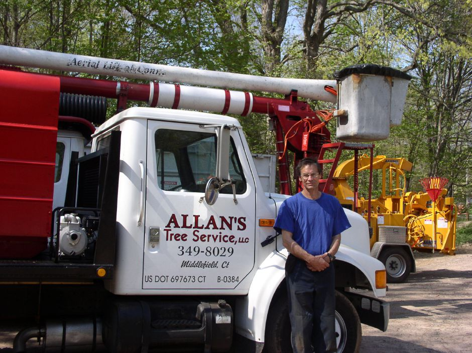 Middlefield resident Allan Poole, owner of Allan's Tree Service, poses with his bucket truck a few years ago. Contributed