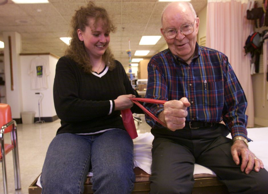 RJ file photo - Robert Painter, 82, of Wallingford, works with occupational therapist Michele Tarantino at Masonic Center, April 1999.