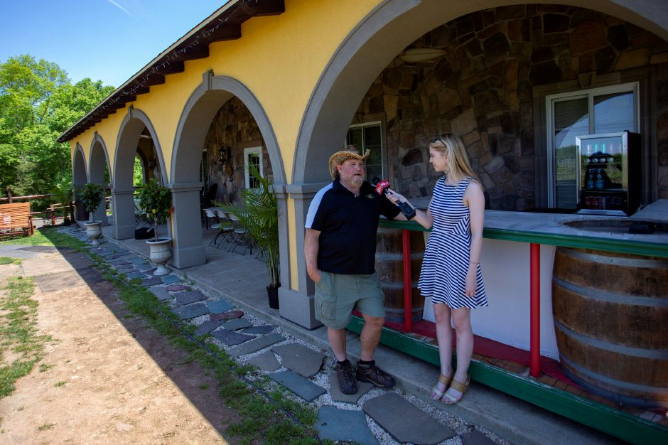 Record-Journal Digital Content Producer Ashley Kus interviews Paradise Hills Vineyards Founder Richard Ruggiero at the Wallingford vineyard May 24, 2018. | Richie Rathsack, Record-Journal