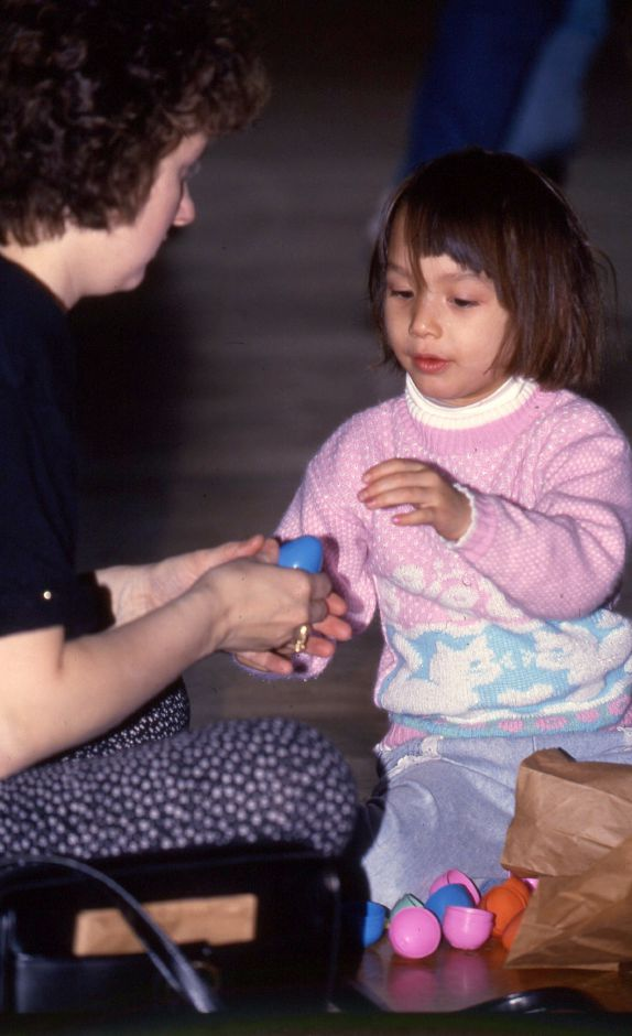 RJ file photo - Lien Vo opens up Easter eggs with her mom Margaret Vo after the Meriden Parks and Recreation Easter Egg Hunt at Platt High School March 1994.