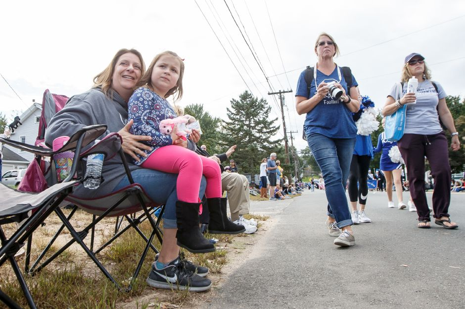 Angela Griffis and daughter Chloe 4 watch as the Southington Marching Band passes Sunday during the Southington Apple Harvest Festival Parade in Southington September 30, 2018 | Justin Weekes / Special to the Record-Journal
