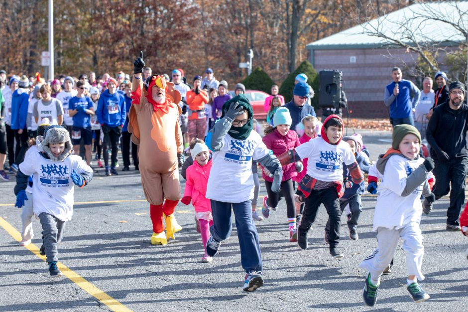 "Children take off from the starting line in the ""Thanks for Giving"" fun run on Oct. 9, 2019. Looping around the Middle School of Plainville, the run raised around $7,000 — over half the money needed to fund the spring sports program at the school. 