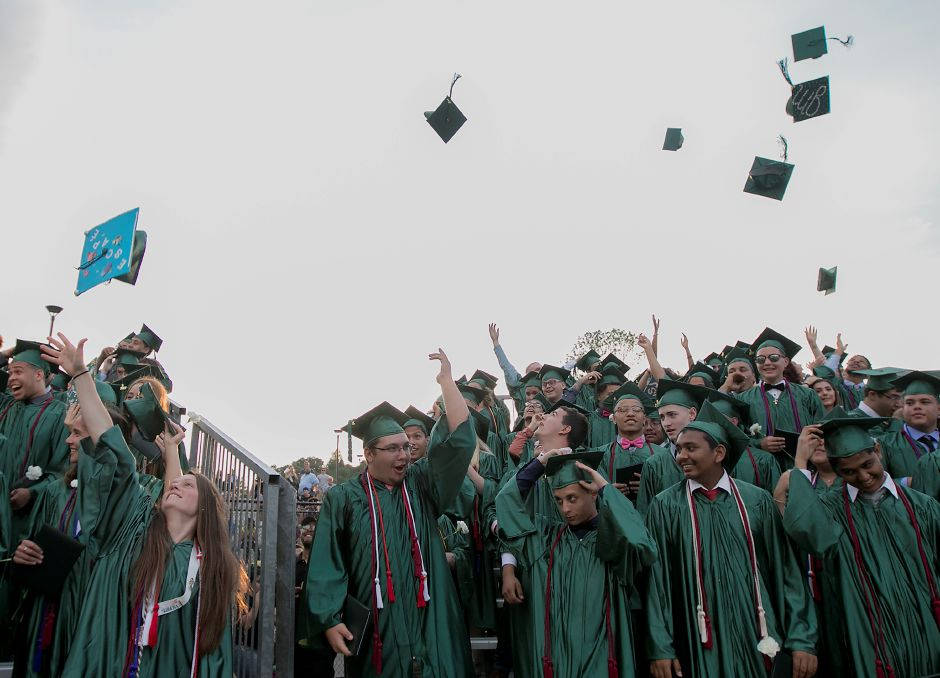 Maloney graduates throw their caps at conclusion of graduation ceremonies at Maloney High School in Meriden, Tuesday, June 13, 2017. | Dave Zajac, Record-Journal