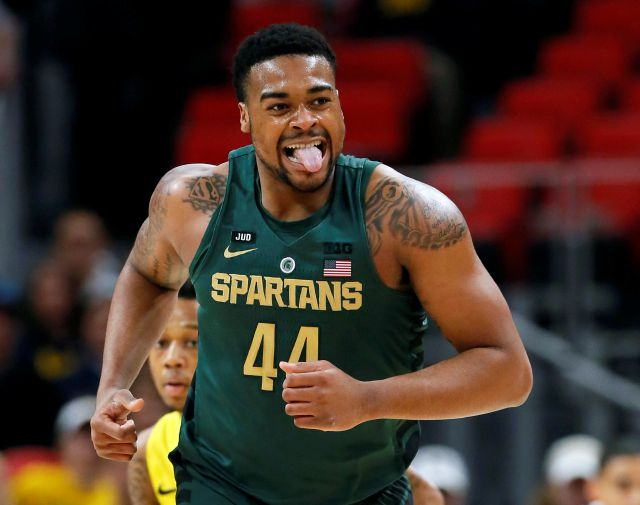 Michigan State forward Nick Ward (44) reacts after missing a shot against Oakland during the first half of an NCAA college basketball game Saturday, Dec. 16, 2017, in Detroit. (AP Photo/Duane Burleson)