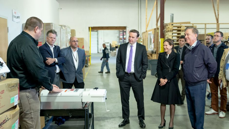 Democratic Senator Chris Murphy, center, Lt. Gov. candidate Susan Bysiewicz and Democratic Gubernatorial candidate Ned Lamont listen to James Star, manager of Trinity Solar in Cheshire. The three candidates toured the company and spoke about the importance of clean energy on Oct. 25, 2018. | Devin Leith-Yessian/Record-Journal
