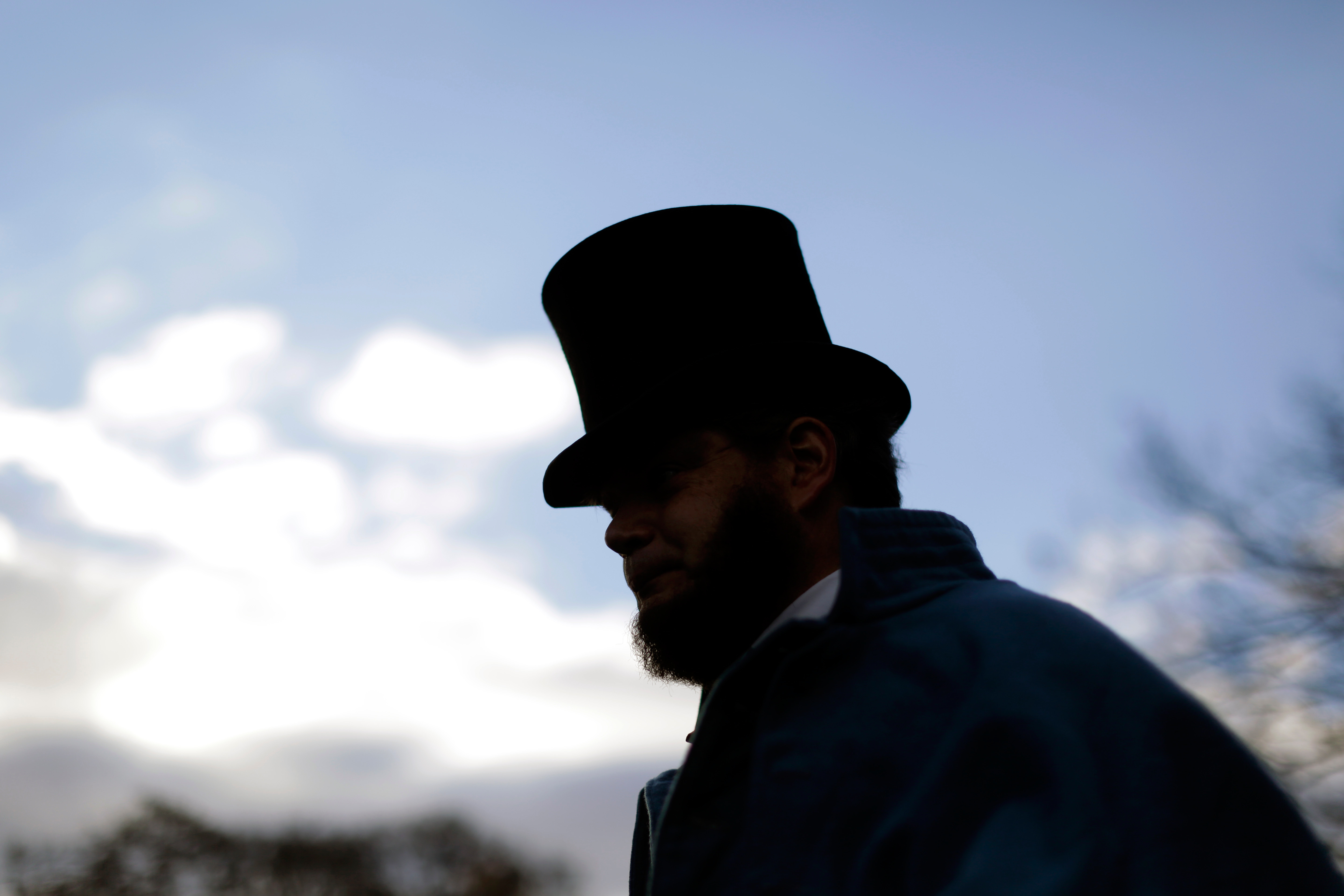 Bryce Stenzel of Mankato Minn., dressed as Abraham Lincoln, arrives before a ceremony commemorating the 150th anniversary of the dedication of the Soldiers National Cemetery and President Abraham Lincoln