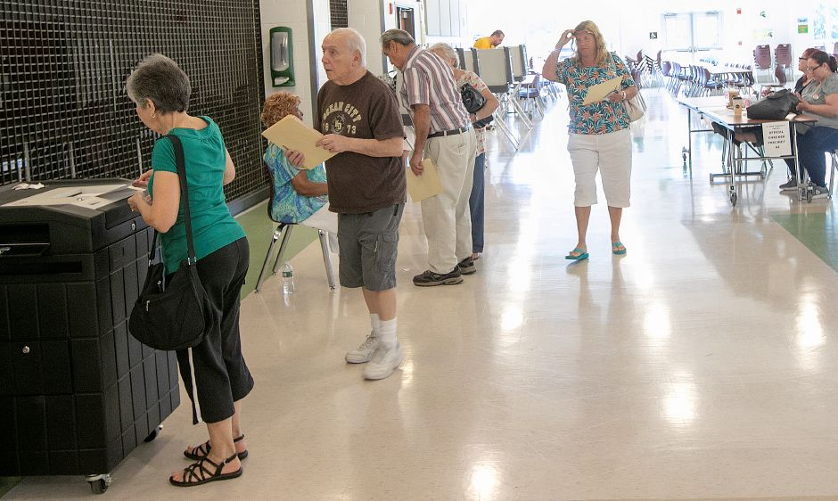 Residents vote at Maloney High School whether to send the adopted 2018-19 budget back to the City Council for changes, Wednesday, July 18, 2018. Dave Zajac, Record-Journal