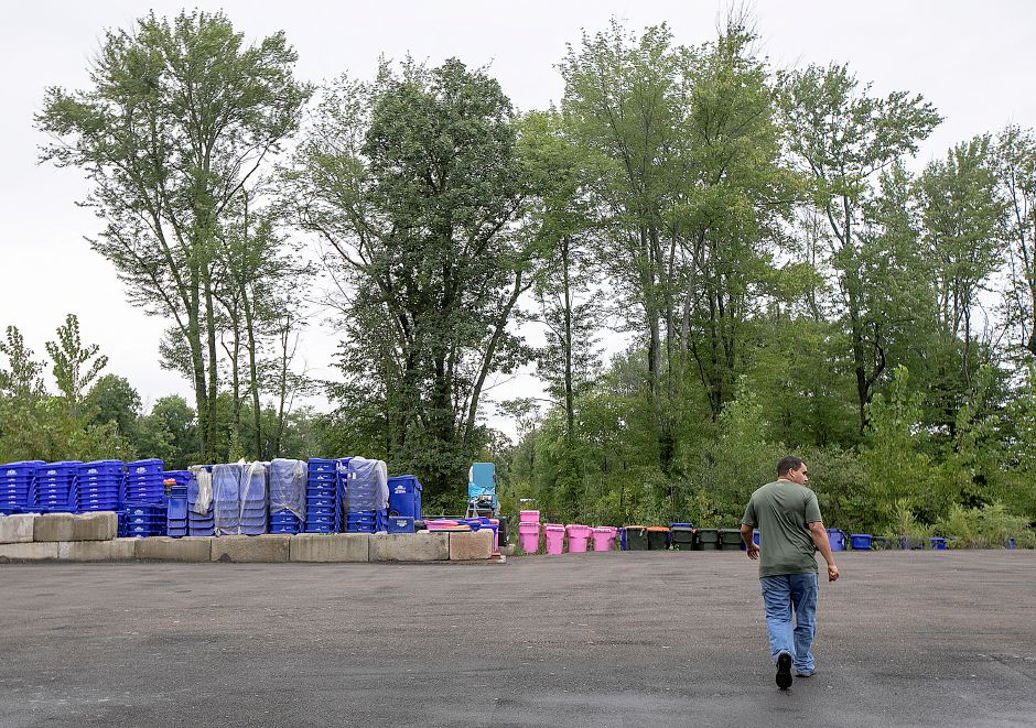 Jack Perry, co-owner of HQ Dumpsters & Recycling, walks through the yard of the business in Southington, Tuesday, Sept. 11, 2018. Residents could see a potential increase in trash pickup fees due to new charges from the facility contracted to collect recyclables from the towns' commercial haulers. Dave Zajac, Record-Journal