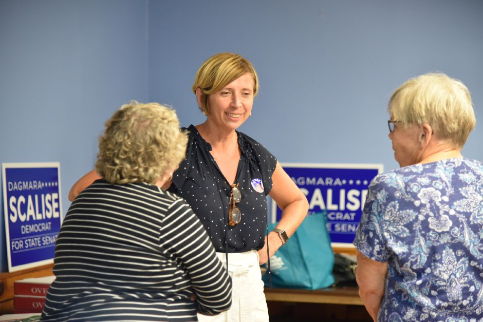 Dagmara Scalise awaits the results of the 16th Senate District democratic primary on Tuesday, August 14, while surrounded by supporters at party headquarters in Southington. | Bailey Wright, Record-Journal
