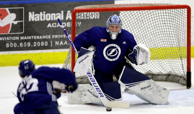 FILE - In this Sept. 13, 2019, file photo, Tampa Bay Lightning goaltender Andrei Vasilevskiy (88) eyes a shot during the first day of training camp, in Brandon, Fla. Fresh off finishing 21 points ahead of the NHL last regular season and going four and out in the playoffs, the Lightning are again Stanley Cup favorites and the team to beat in an ever-improving the Eastern Conference. (AP Photo/Chris O