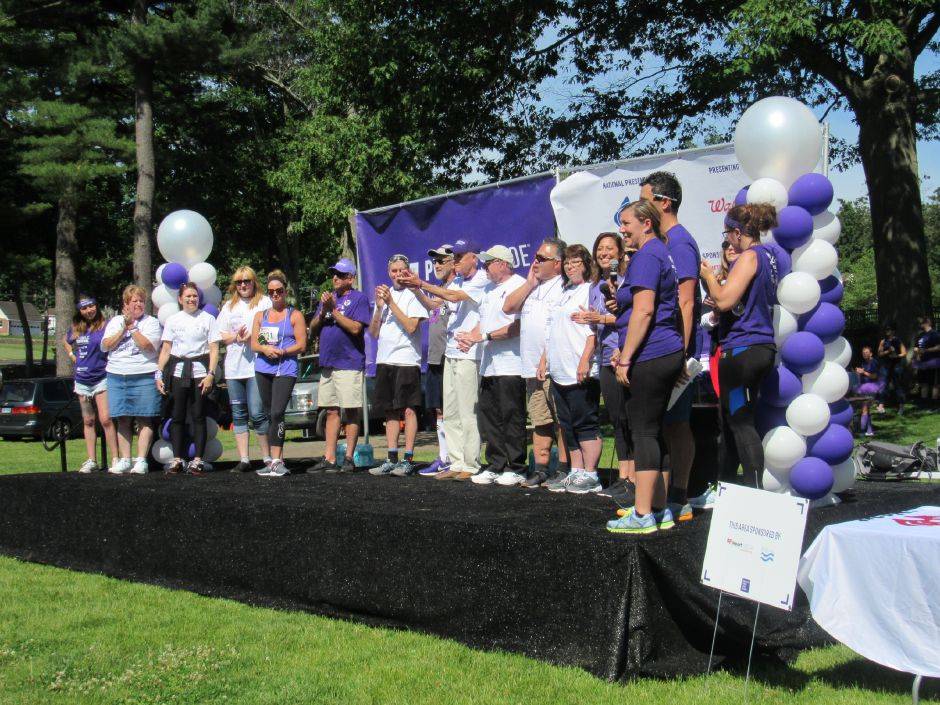 A group of cancer survivors on stage during the opening ceremony of the Pancreatic Cancer Action Network's the Purple Stride walk in Hubbard Park. Saturday, June 15, 2019. | Jeniece Roman, Record-Journal