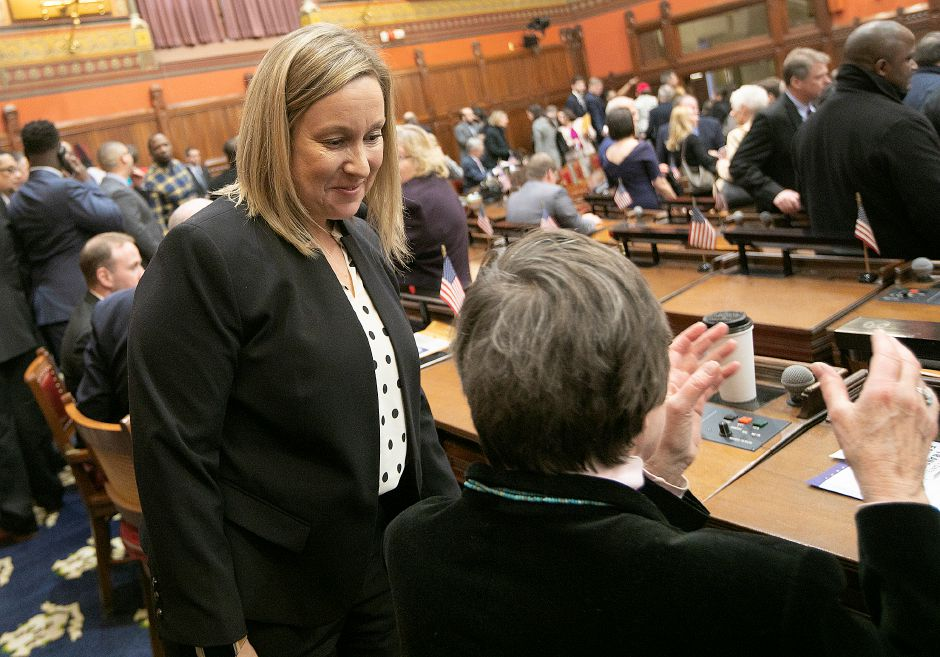 Rep. Liz Linehan, left, talks with Rep. Mary Mushinsky during opening day of the legislative session in Hartford, Jan. 9, 2019. | Dave Zajac, Record-Journal