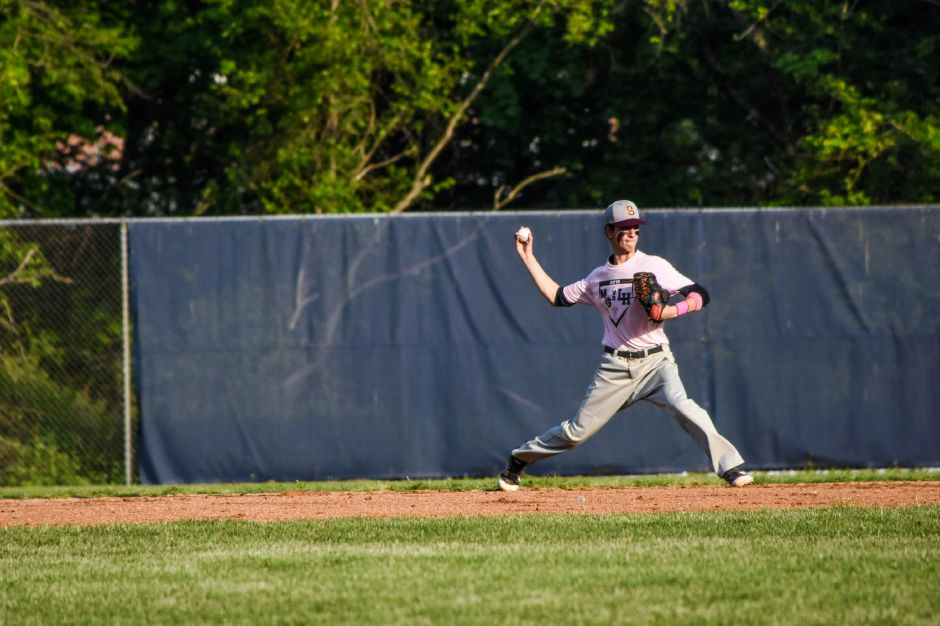 Nick Cresale fields a ground ball during Friday night's Lyman Hall-Sheehan rivalry game at Pat Wall Field. | Jim McGovern, Special to the Record-Journal